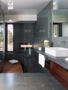 La Vinya by Lagula Arquitectes | great #modern #minimalist #bathroom ensuite design with great use of large format tile, rectangular basins, framless glass and rain shower head