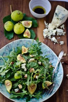 Arugula, fig & blue cheese salad | Scaling Back 1 tablespoon balsamic vinegar 1/4 teaspoon dijon mustard 1/4 cup extra-virgin olive oil salt and pepper to taste 1 large bunch arugula 1 pint fresh figs, cut into quarters 4 oz smoked blue cheese, crumbled 1/4 cup toasted chopped hazelnuts