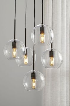 Clear spheres dangle a contemporary chandelier over dining room tables or kitchen islands. Dark bronze hardware adds contrast, while adjustable cord lengths create the right amount of stagger. Dining Room Remodel, Farmhouse Lighting, Dining Lighting, Dining Room Small, Dining Room Lighting, Farmhouse Dining Room, Kitchen Chandelier, Dining Room Contemporary, Contemporary Chandelier