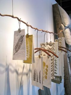 Way to display the tea towels. Could be adapted to other things like jewellery.