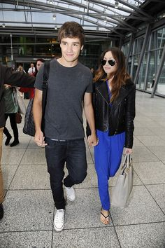 Liam Payne and girlfriend Danielle Peazer arriving at Heathrow Airport on July 16, 2012