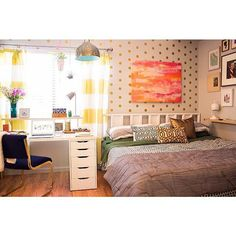 Take your pick, because there are plenty of tips to pick up from this instagrammer: polka-dot wallpaper, a floating nightstand shelf on one side and a desk on the other, bright-striped curtains, and a pendant lamp. Even with so much going on, it all manages to feel cohesive.  Source: Instagram user realityandretrospect