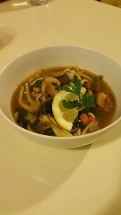 Linguine noodle dish with chicken broth mixed in with mushrooms and spinach.