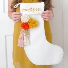 Make your own felt stockings adorned with pom poms this Christmas.