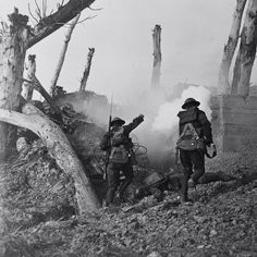 America in the Great War: Historic photos to mark 100 years since the U.S. entry into World War One.  Photo 1: American soldiers charge an enemy position.  Photo 2: An American gun crew from Regimental Headquarters Company, 23rd Infantry, fires a 37mm gun during an advance against German entrenched positions. Photo 3: American soldiers move equipment along a dirt road in Saint-Ouen-les-Parey, France, February 1918. Photo 4: American soldiers react to a gas attack, likely used for training…