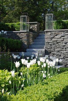 Garden steps #BEautifulBackyard #YardIdeas #GardenEntrance #Steps #stonewallgarden #RealPalmTrees RealPalmTrees.com