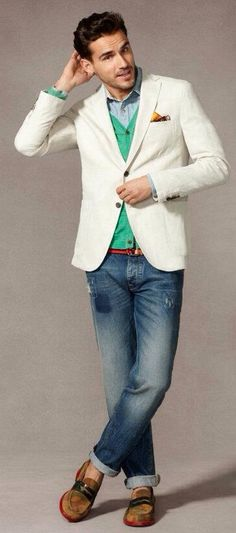White linen Blazer, Green Sweater Vest, Broken in Jeans, and Red Soles Brown Suede Loafers. Men's Spring Summer Fashion.
