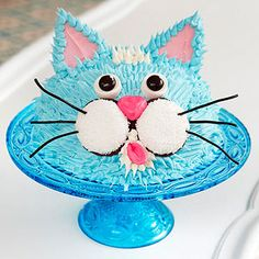 For the animal-loving child, this kitty cake hits it right on the mark. While the furry effect looks complicated, don't worry! Simply use a fork to lightly pull the frosting outward to resemble a cat's coat.