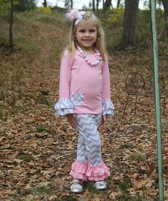 With girly ruffles and sweet colors, this coordinated set brings extra oomph to a little cutie's adventures. A stretchy cotton blend and a roomy cut guarantee a comfy and cozy fit.