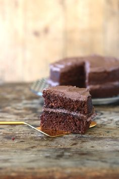 A big slice of a light and fluffy easy vegan chocolate cake recipe. This vegan cake tastes delicious and is really easy to make with no unusual ingredients!