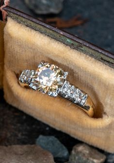This lovely fancy color vintage diamond engagement ring features a 1.46 carat center diamond and is priced at $6850. Sku AG17877.
