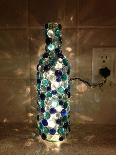Image 4 of 17 from gallery of Cool DIY Bottle Lamp Ideas To Add Unique Home Decor. This diy glass bead wine bottle lamp is can add glowing effect to any room Glass Bottle Crafts, Wine Bottle Art, Lighted Wine Bottles, Bottle Lights, Decorating Wine Bottles, Crafts With Wine Bottles, Glass Bead Crafts, Bead Bottle, Crafts With Glass Bottles