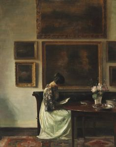 .:. Carl Holsøe (Danish, 1863-1935), Interior with the artist's wife reading