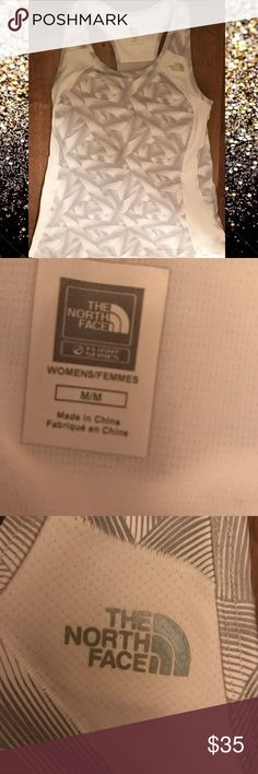 NWOT North Face Tank Medium Never worn. Built in bra. Amazing for working out just didn't fit me. The North Face Tops Tank Tops