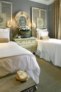 Shutters as headboard, maybe use the iron gates, but would need to figure out how the grandkids would avoid banging their heads.