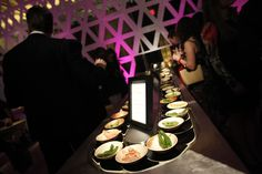 Occasions Caterers took inspiration from Japanese sushi restaurants and set up a conveyor belt of small plates. Photo: Paul Morigi/Getty Images