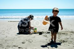 Grandmother and Grand build Sandcastle royalty-free stock photo