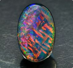 """""""Chinese Writing"""" flash black opal.... This isn't a boulder opal...it's just a magnificent opal...I had to include it in....wow...it's worth every penny they asked for it...and I'm sure it wasn't cheap..."""