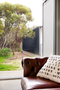 The Contemporary Weekender by Twinkle & Whistle (for Scoop Magazine) - Master Bedroom: polished concrete floors, steel structure, Chesterfield couch and hessian cushion - Craig Steere Architects