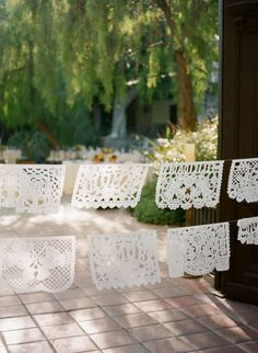 all white papel picado  Photography by http://erinheartscourt.com, Wedding Coordination by http://inthenowweddings.com