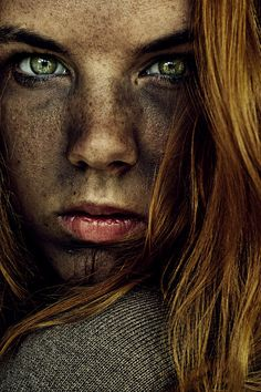 Very well processed photo.  Her eyes are piercing and bright to contrast the dirtiness and grunge of the rest of her face.