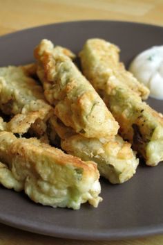 Fried buttermilk pickles----    The seasoned crunchiness of the batter gave way to the warm, moist, salty pickle inside. Paired with a tasty ranch or chipotle dip and it's a sure win-