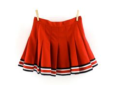 5c940ecb54 Super sassy vintage pleated cheerleader skirt in red with black and white  trim. Description from