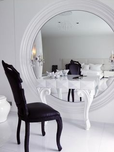 love the unexpected shape and scale of this round mirror for a vanity table