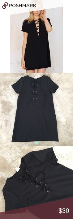 Nasty Gal Lace Up Short Sleeved Dress Black tee shirt style dress with front lace-up detail, shift silhouette and raglan cap sleeves. Polyester. Length is pictured. Good condition. Nasty Gal Dresses Mini