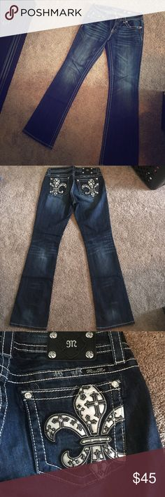 """Miss Me size 30 boot cut Cute Miss Me Jeans size 30 mid rise boot cut jeans with fleur de lis on the pockets.  Cute accents as well on pocket sides and fun button.  Lightly worn they are long enough for someone 5'10"""" tall super cute on with boots or just sandals. Miss Me Jeans Boot Cut"""