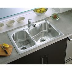 This double bowl kitchen sink has convenient bowl sizes for washing dishes.