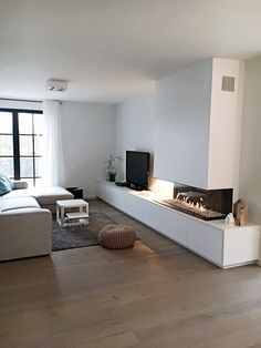 Modern fireplace design | seating area by the fireplace | living room #fireplace | http://shopstyle.it/l/Gtj8