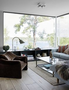 A sitting room / living room with a view over the water in A Striking Swedish Su., A sitting room / living room with a view over the water in A Striking Swedish Summer Cabin On The Island of Ingarö Modern Wooden House, Modern House Design, Modern Interior Design, French Interior, Interior Exterior, Room Interior, Interior Doors, Contemporary Cabin, Small Room Design