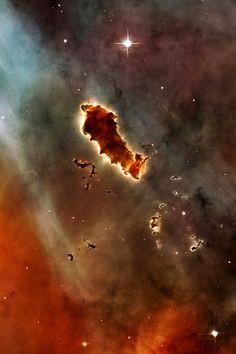Globules of metallic supernova ash in the Eta Carinae Nebulae.
