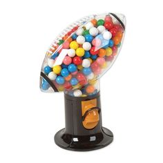 Football Snack Candy and Gumball Dispenser (Gumball Machine) by DOMAGRON. $10.99. Also works with small candies such as M and M. Candy and gumballs not included. Just fill with your favorite goodys and lift the handle for a mesaured snack. Does not require coin for operation. Pop off the top and load up for big  fun. Holds approximately gumballs, snacks, and small candies which are sold separately. Does not requires coin for operation. Made of plastic - no worries about br...