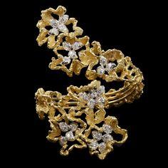 GILBERT ALBERT Geneva.c1970.Striking oro de 18 quilates y un diamante amarillo de cruce pulsera brazalete