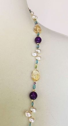 For Sale on - This elegant necklace is composed of brilliant citrine, amethyst, blue topaz, peridot beads, and glowing pearl drops. Highlighting the elegant curves of Diy Jewelry Necklace, Handmade Necklaces, Beaded Necklaces, Bead Jewelry, Jewelry Making, Long Necklaces, Coral Jewelry, Jewellery, Lariat Necklace