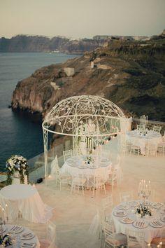 Scenic Outdoor Reception at Cavo Ventus Luxury Villas   Anna Roussos, Santorini, Greece   TheKnot.com