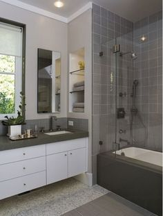 Take advantage of the space between your studs by creating a storage shelf in between them. Also- lifting the cabinet off the floor gives it a light and airy floating look. This makes the bathroom feel more spacious than it actually is