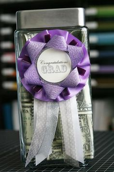 "Graduation gift idea, everytime your child gets an A, put a dollar in their jar. When they graduate High School give them the jar with all their ""A Money""."