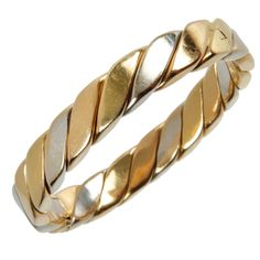 White and Yellow Gold  Oval Hinged Bracelet | From a unique collection of vintage modern bracelets at http://www.1stdibs.com/jewelry/bracelets/modern-bracelets/
