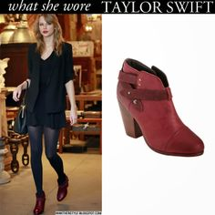 Taylor Swift in dark red burgundy  ankle boots with black jacket and black mini skirt