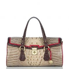 I call my purses pets. I would love to add this to my litter!