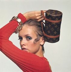Posing with a mini Louis Vuitton bag for a 1967 editorial.