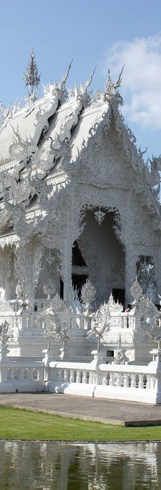 Wat Rong Khun, Thailand~ is a contemporary unconventional Buddhist temple in Chiang Rai, Thailand. It was designed by Chalermchai Kositpipat. Construction began in 1996 and is expected to be completed 60 - 90 years after the death of the artist and designer.