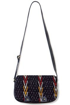 Made from hand-loomed ikat and eco leather, this shoulder bag is perfection