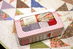Frivols Collectible Tins by Moda Fabrics  No. 4  Windermere by Brenda Riddle Designs.   More to come.....