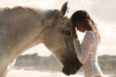 beautiful girl with horse on the beach