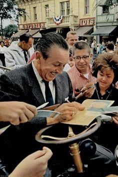 Walt Disney signing autographs