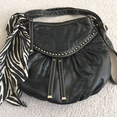 "MARC ECKO STUDDED CROSSBODY Used, but in excellent condition. No rips or marks in the outside. There's a little bit of creasing and slouch on the bag as pictured because of storage. The strap has some creasing and the hardware has some scratching. The interior is in great condition with one small pen mark. MEASUREMENTS: 12.5"" across 8.5"" opening 11.5"" height and 21"" strap drop is the longest it can be adjusted. NO TRADES  REASONABLE OFFERS  Comment any questions you might have! :) I also…"